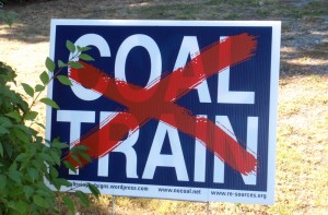 A sign against Coal Train in White Rock